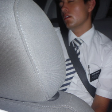 Elder Okano Sleeping In Hitch-Hiked Car